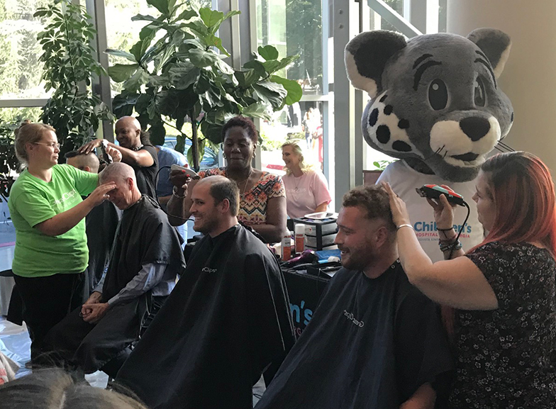 people getting their hair shaved