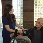 a woman takes a man's blood pressure
