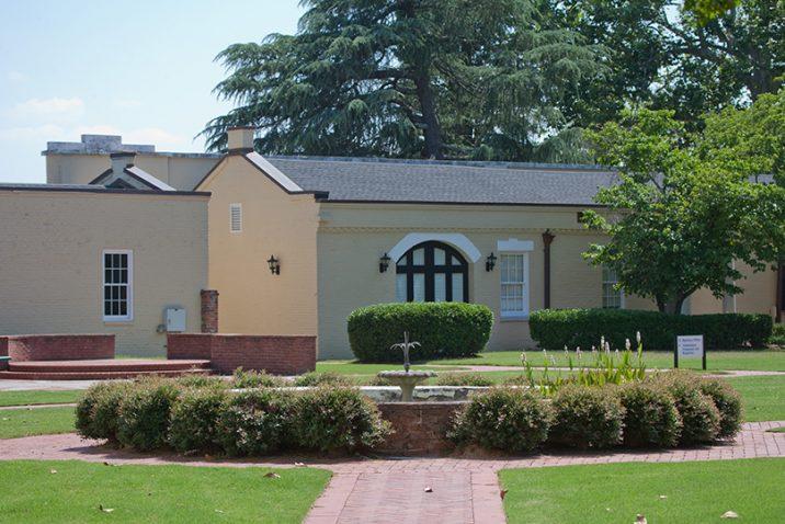A photo of a building and a garden.