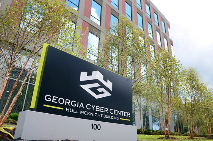 exterior of a building with a sign that says georgia cyber center