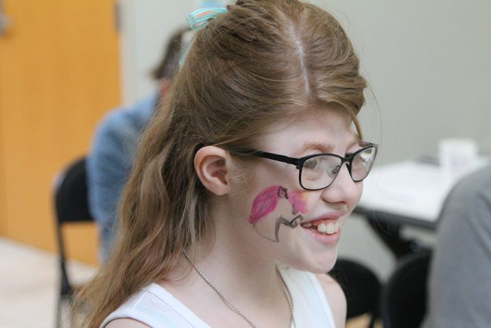 Girl shows off her face painting