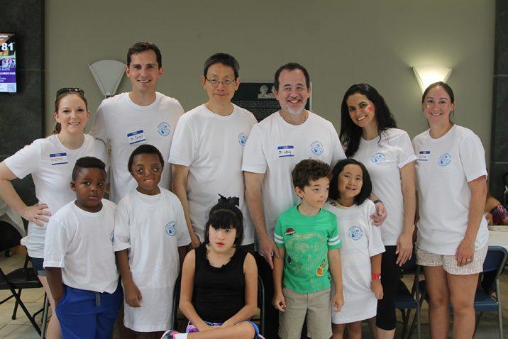 Doctors and children posing