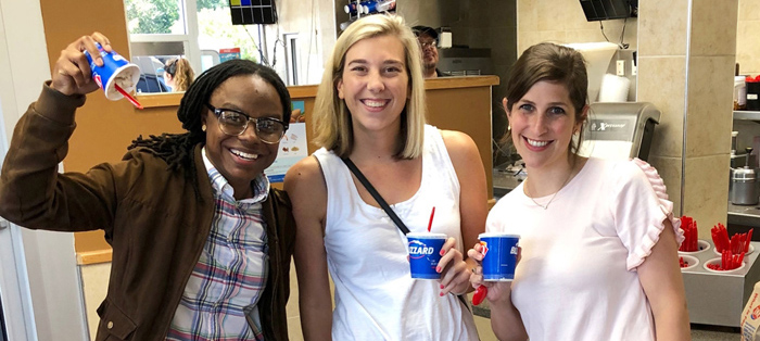 Three Augusta University smiling with Dairy Queen blizzards.