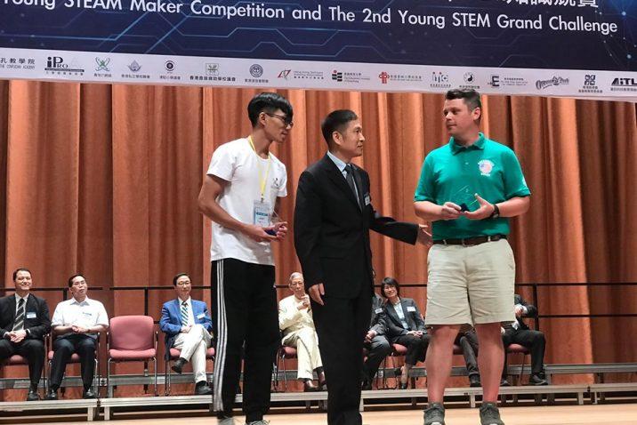Teacher receiving an award.