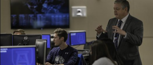 man teaching class in computer lab