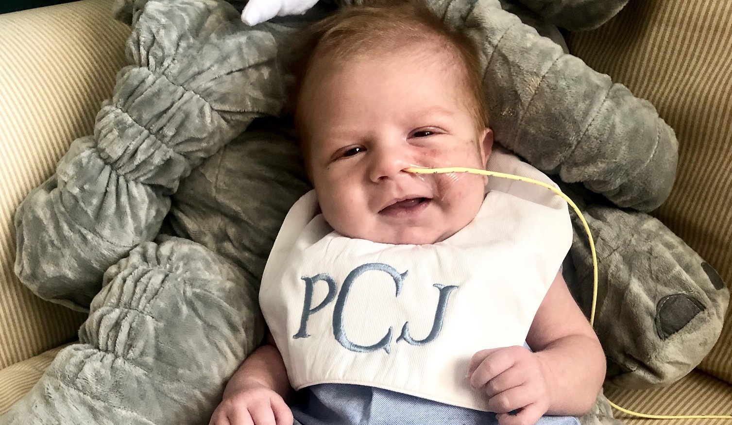 baby with breathing tube in his nose