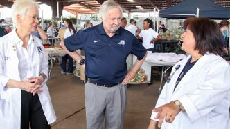 Students from several Augusta University colleges spent the day providing health screenings at Costa Layman Farms.