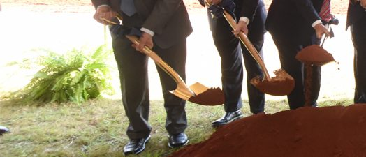 men with shovels at groundbreaking