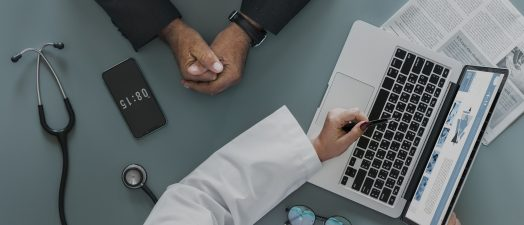 Doctor discussing image on computer screen with patient