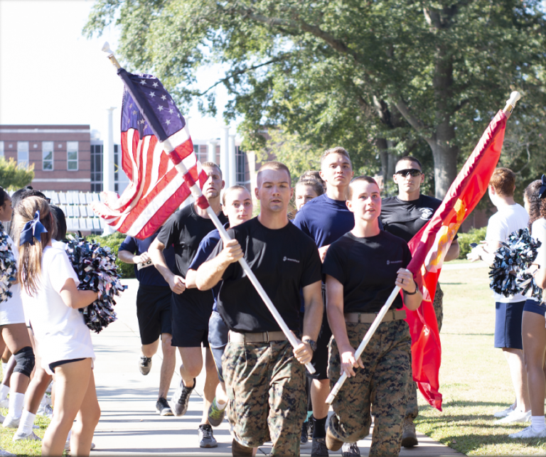 Soldiers carrying flags.