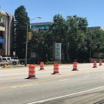 Orange and white construction drums lined up along 15th Street in front of AU Medical Center