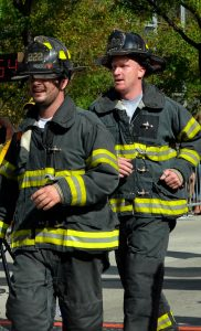 Two firefighters running