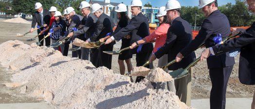 People shoveling sand