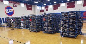 Cots in gymnasium