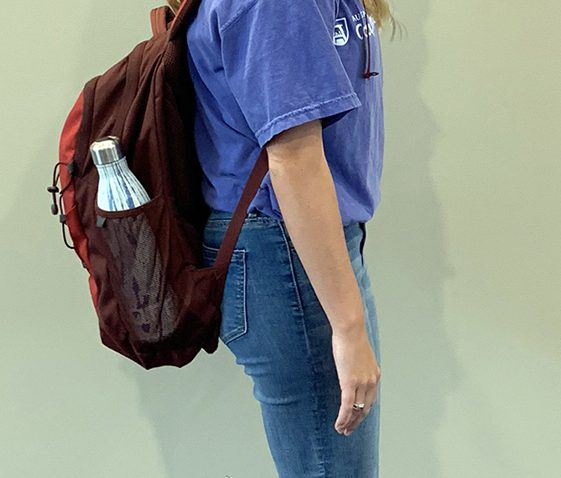 Person standing with backpack