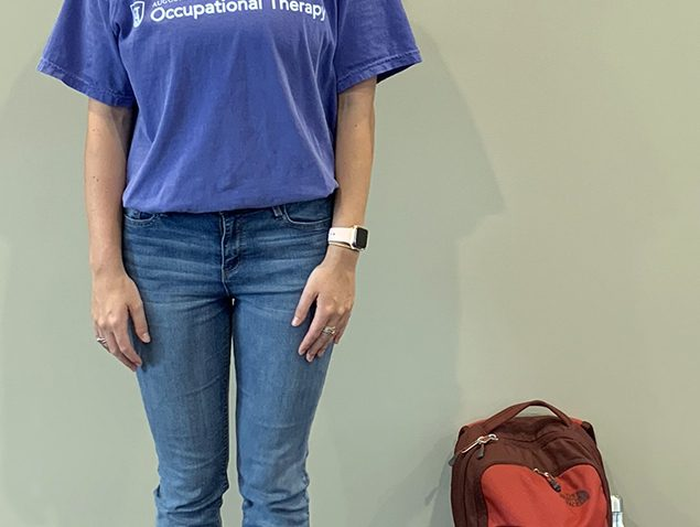 Woman on scale with backpack