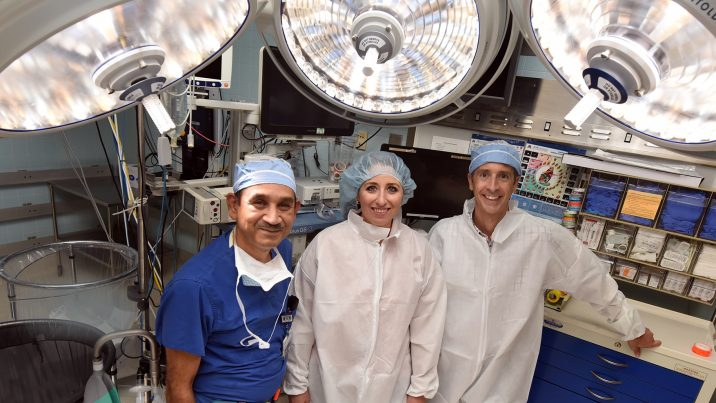 Three doctors in operating room