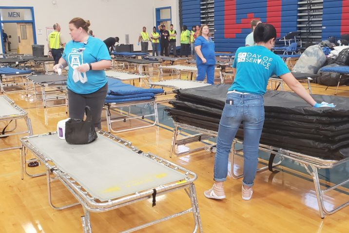Volunteers put up cots