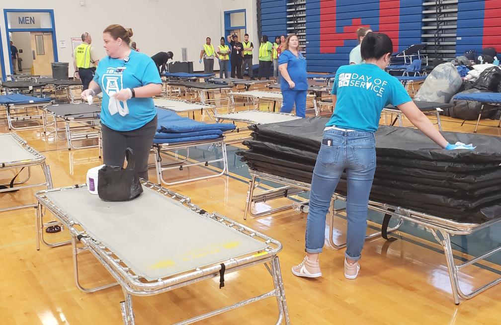 Volunteers put up cots