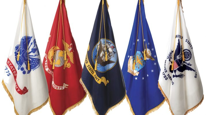 Image of U.S. Army, U.S. Marine Corps, U.S. Navy, U.S. Air Force, and U.S. Coast guard flags side by side.