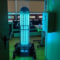 A robot giving off UV light in a hospital room.