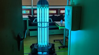 A robot giving off UV light in a hospital room.