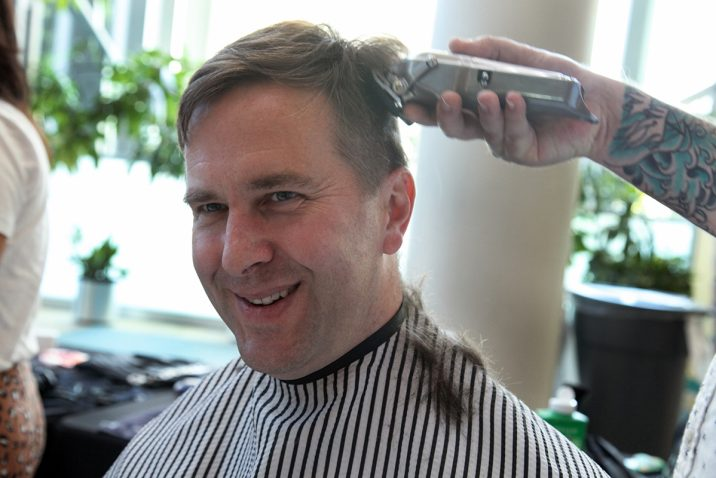 Person getting their haircut for fundraiser