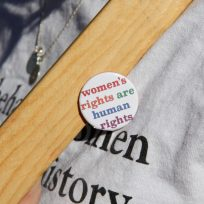 pin on shirt that says women's rights are human rights