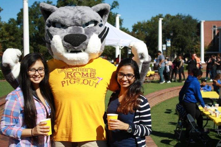 students smiling with mascot