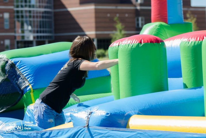student jumping inside inflatable game