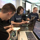 Students sitting around computers.
