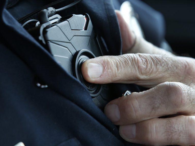 An officer with a body-worn camera.
