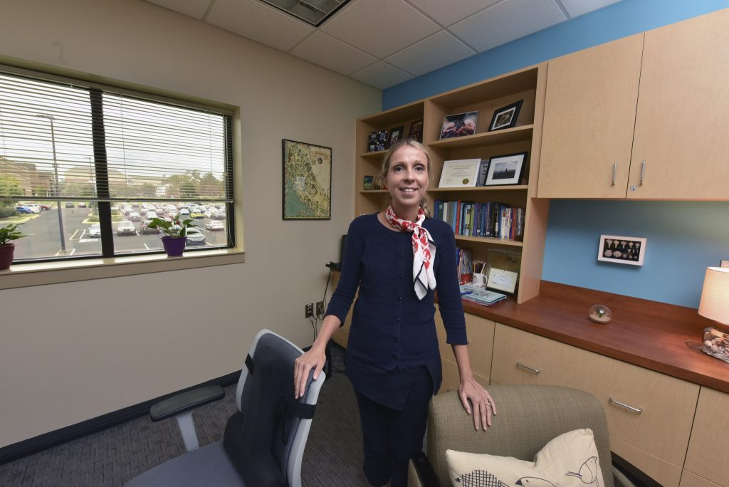 Dr. Elena Petrova pictured in her office on the Summerville Campus