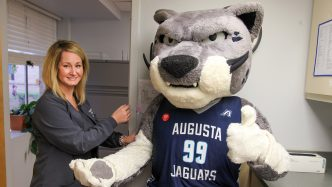 Photo of AU mascot Augustus getting a mock flu shot