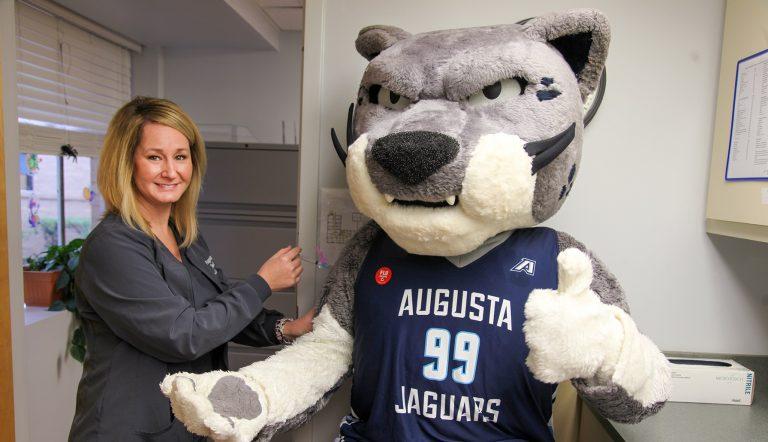 Photo of AU mascot Augustus getting a mock flu shot