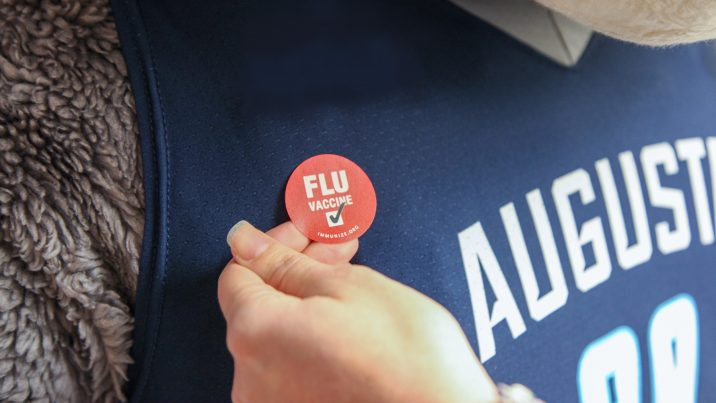 Image of red flu sticker on AU mascot Augustus's shirt