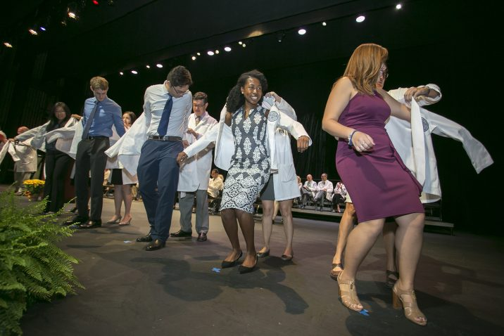 Students getting white coats