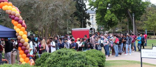 Students standing outside in line