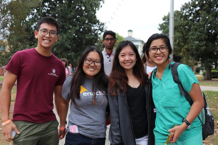 Four students smiling at camera