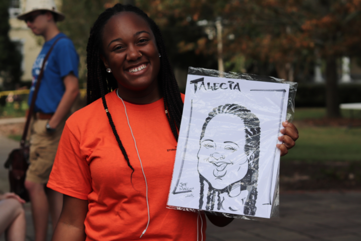 students smiling with custom drawing