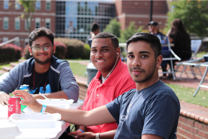 students smiling while eating