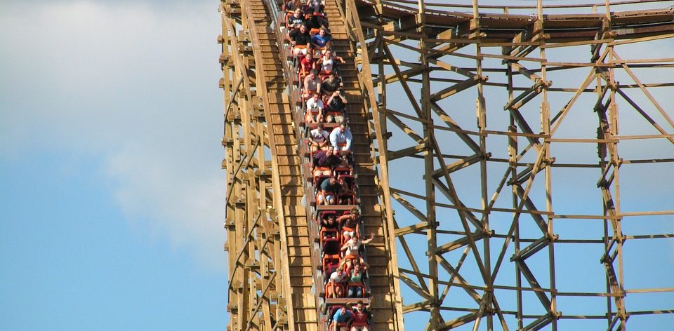People going downhill on wooden rollercoaster