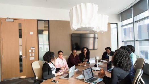 people gathering in a conference room