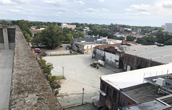empty dirt lot behind building