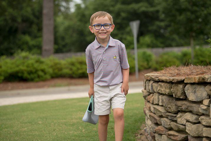 boy smiling outside