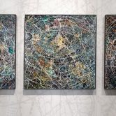 Three paintings on a wall.