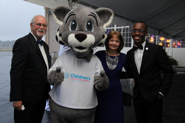 people at gala with mascot