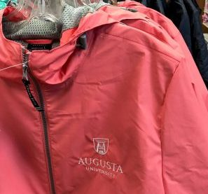 pink raincoat with Augusta University logo
