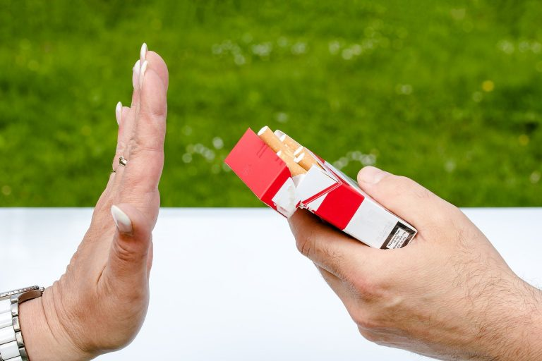 "Photo of someone saying ""No"" to a pack of cigarettes."