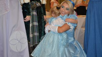 girl hugs Cinderella